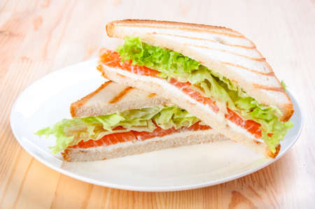 club sandwich with salmon, cheese, lettuce Stock Photo
