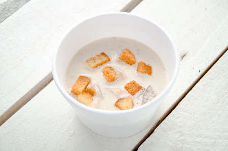 creamy soup with croutons in the plastic box photo