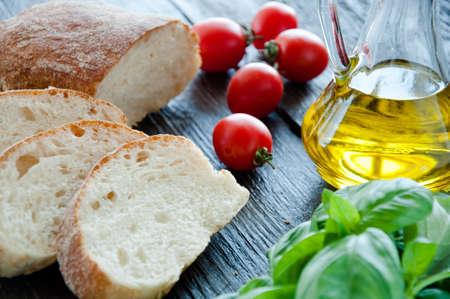 Bruschetta Ingredients for preparation:ciabatta,oil, tomato, garlic, basil photo