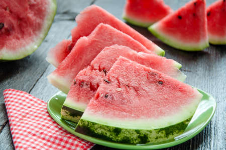 Ripe watermelons on table on wooden background Stock Photo