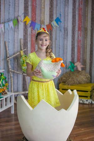 beautiful girl in the yellow chicken costume photo