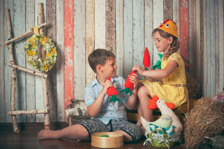 young children playing with toys in studio photo