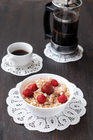 Cereal with strawberries and raspberries for breakfast