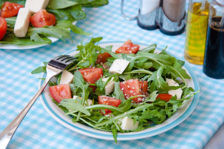 ruccola: fresh salad with mozzarella, ruccola and tomatoes