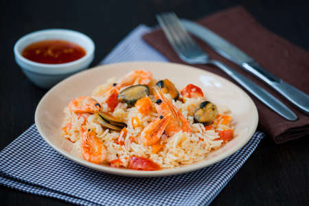 Thai dish of stir fried rice noodles with prawns and mussels photo