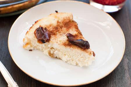 Piece of cottage cheese casserole with raisins photo