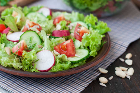 Tomato and cucumber salad with lettuce