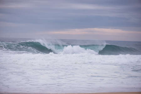 crashing: Wave crashing on a coast in Nazare, Portugal Stock Photo
