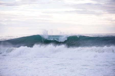 crashing: Wave crashing on a coast in Nazare