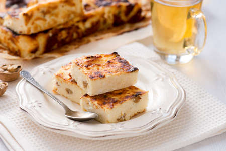 Appetizing cottage cheese casserole with raisins, close up