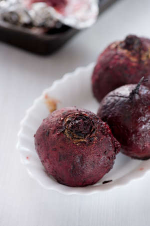 aluminum foil: Fresh roasted beetroot served in the aluminum foil in the plate