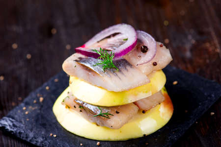 fragrant: Appetizer canape with herring and apples Stock Photo