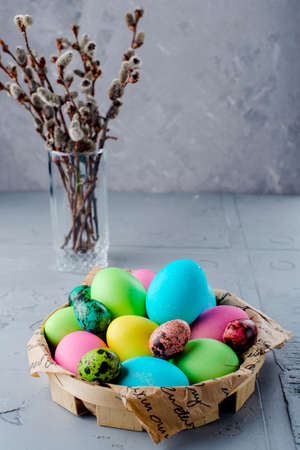 pink pussy: Colorful Easter eggs in the basket with willow branches Stock Photo