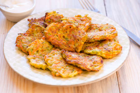 fres: fried fritters of shredded courgette, food closeup Stock Photo