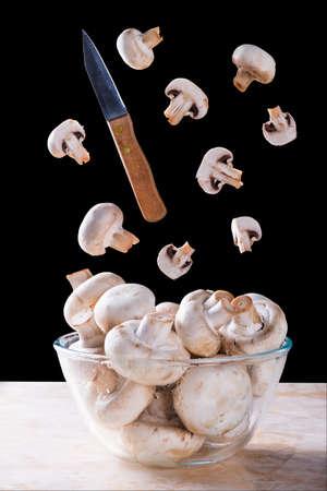 levitation: Sliced mushrooms and knife in levitation Stock Photo