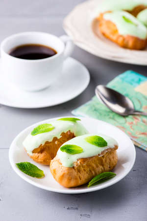 Breakfast with mint eclairs and coffee cup