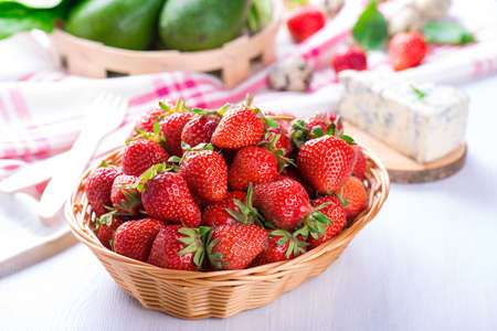 fresh strawberry in the basket on white wooden table Stock Photo