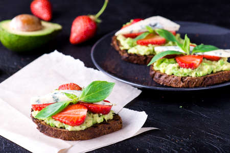 Sandwich with strawberry on white craft paper