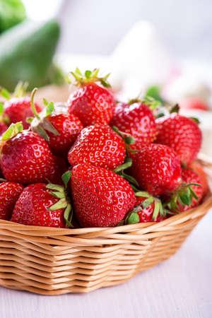 Fresh strawberries harvest in the basket