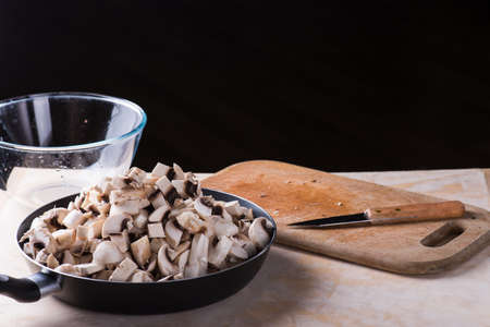 fresh mushrooms cut on the wooden desk