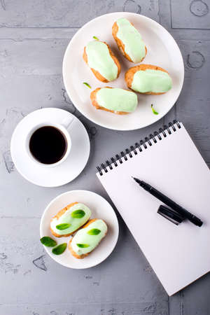 Making your list while having cup of coffee with eclairs
