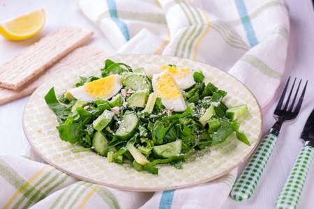 Fresh green salad with spinach, avocado, cucumner, eggs