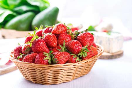 fresh strawberry in the basket on white wooden table Standard-Bild