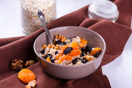 Oatmeal with raisins, dried apricots, plums