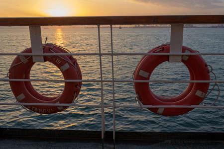 Orange lifesavers on the deck of a cruise ship