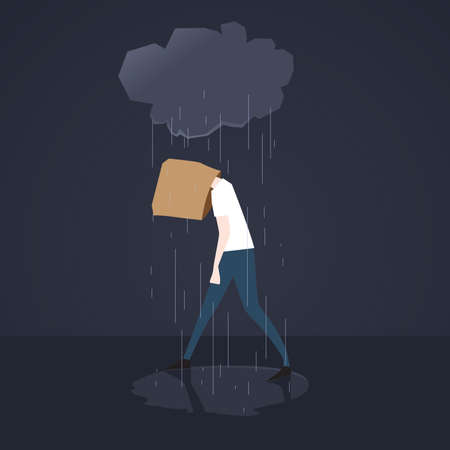 hunched: Depressed man walks in the rain with paper bag on his head
