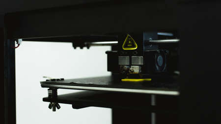 Process of printing physical plastic model on automatic 3d printer machine. Additive technologies, 3D printing and prototyping industry concept. 3d printing details. 3d printer for printing multi-colored toys.