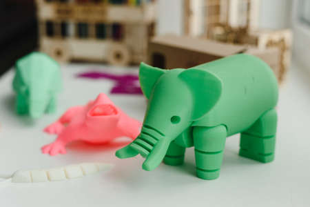 3D figures printed on an elephant, lizard, and snail printer. 3d toys for children Imagens