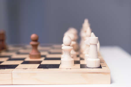 wooden chess on a chessboard. The concept of progress, investment, responsibility and risk in a financial game. checkmate. Banco de Imagens