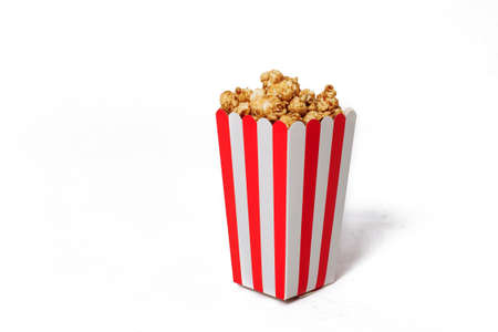 Movie Popcorn in striped bucket isolated on white background.