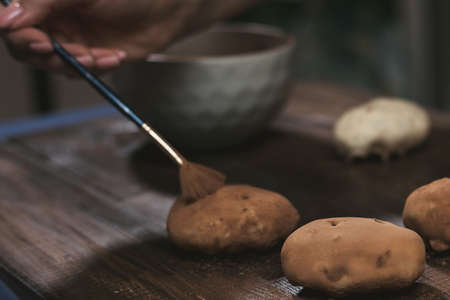 cooking potato cake on a dark wooden background. cooking rum ball.