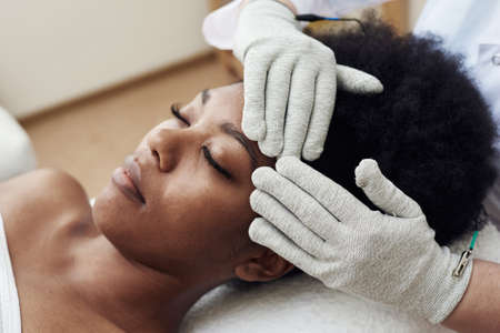 Face rejuvenation with the help of microcurrent therapy. Lymphatic drainage massage. Micro sensory electrical BIO EMS microcurrent treatment for face and body electro stimulation and muscle toning Standard-Bild