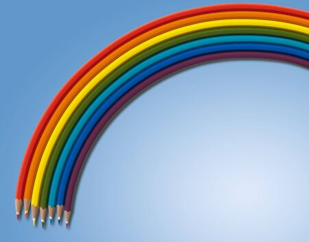 Rainbow from colored pencils on blue background Stock Photo