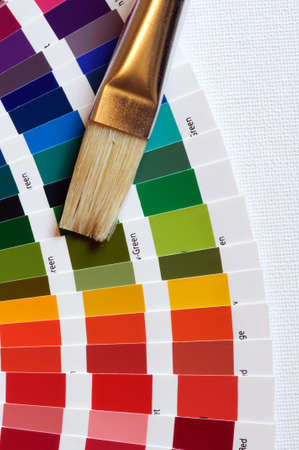 artist brush on multicolored color chart on art canvas Stock Photo - 7000643