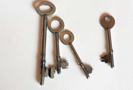 family unit: group of old keys depicting a family unit and new friend