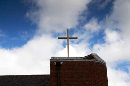 Church cross against moody spiritual sky