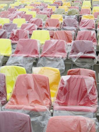 cellophane: Colored seats under a cellophane layer                                Stock Photo