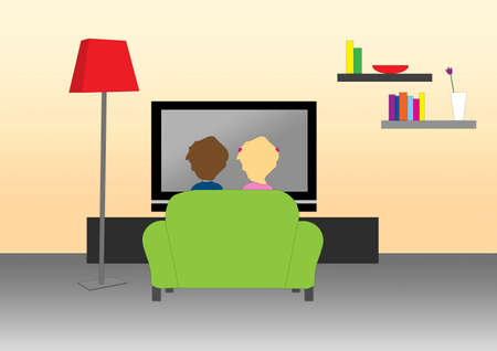 man watching tv: A tender couple at home watching the television on a green sofa