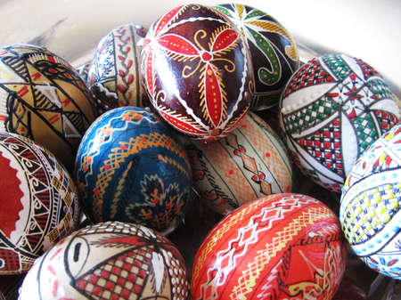 Close-up view of a bowl with many Romanian decorative eggs photo
