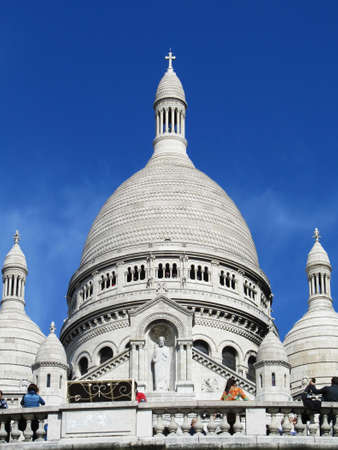 View from below of the Montmartre cathedral with its white domes on the blue sky                                Stock Photo - 13725912