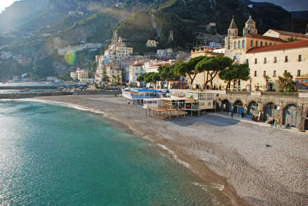 View of the golden beach of Amalfi with its white houses and beautifull blue sea photo