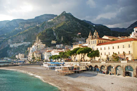 View of the golden beach of Amalfi with its white houses and beautifull blue sea