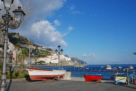 A view of the white houses of Amalfi from the port of the sea town