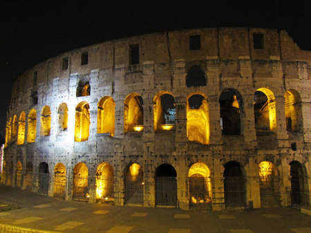 Night view of the Colosseo in Roma with yellow lights