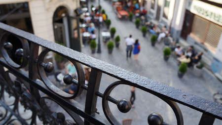balustrades: View from the balcony in the city center watching people walking