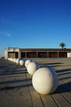 View of spherical urban seats in a pedestrian area near the coast of Palermo photo